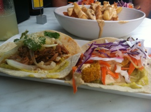 An image of a pork and fish soft shell taco with thick cut chips