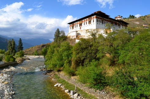 Paro Dzong nestled in the trees by the river