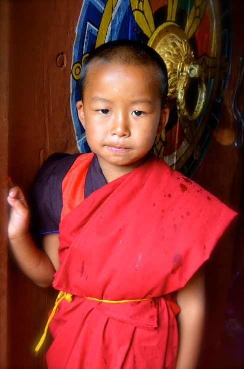 Picture of innocence...a little Buddhist Monk stands by the door