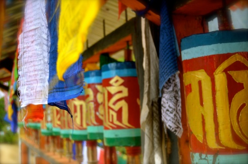 Prayer flags and wheels mark the way to Taktsang