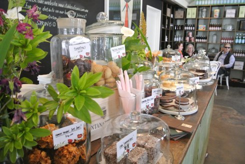 Glass jars filled with sweet treats and baked goods