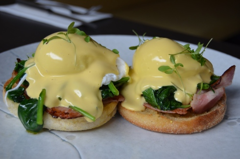 Eggs Benedict and Florentine with lashings of hollandaise sauce, spinach and bacon