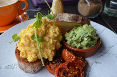 Scrambled eggs on ciabatta with honey roasted tomatoes and lemon, mint and basil avocado