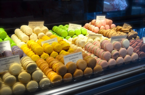 The glass cabinet is brimming with macarons