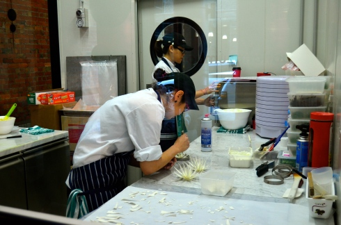 Pastry chefs making the flowers for the famous V8 cake