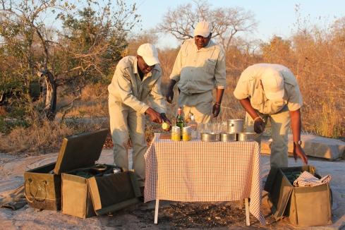 Safari staff preparing sunset drinks