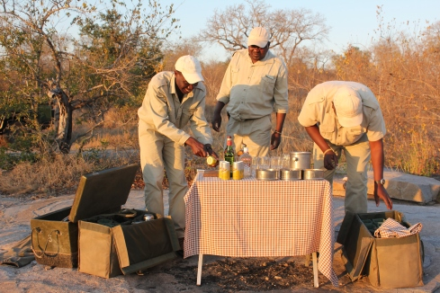 Safari staff preparing sunset drinks
