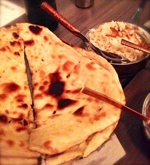 Freshly baked naan and basmati rice