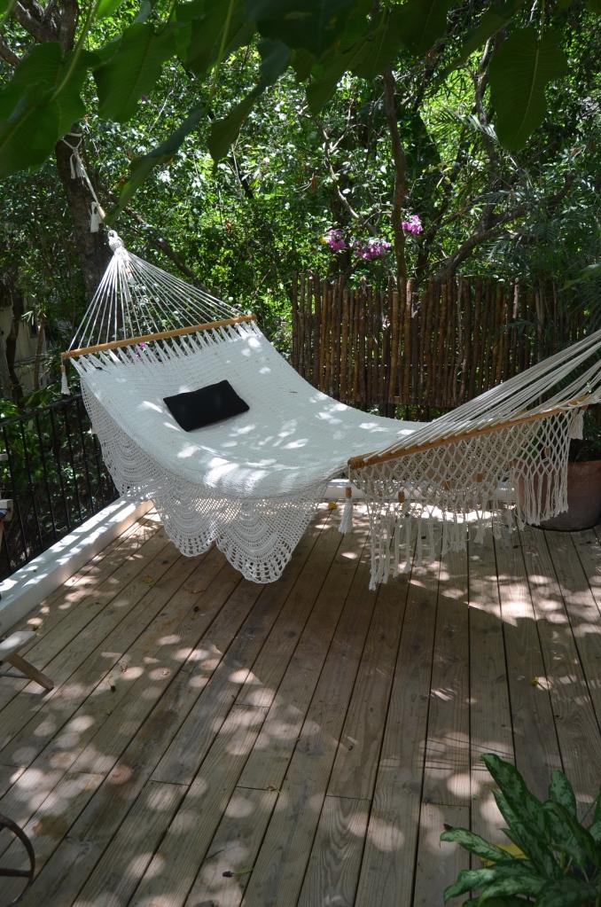 Terrace with hammock at Hotel La Semilla