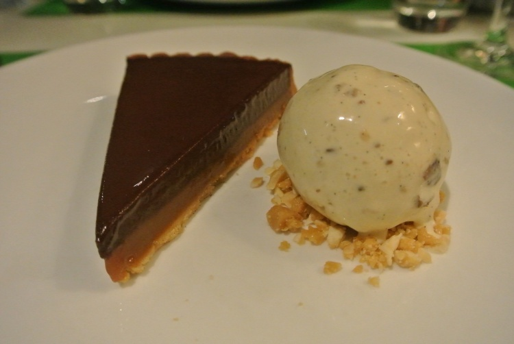 Dark chocolate and salted caramel tart with rum and raisin ice-cream