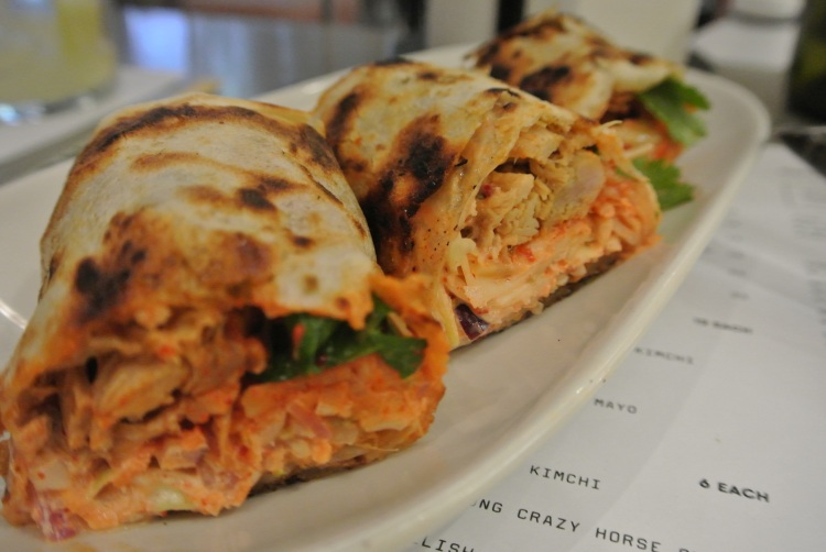 Pulled pork roti roll with slaw kimchi and burnt chilli mayo