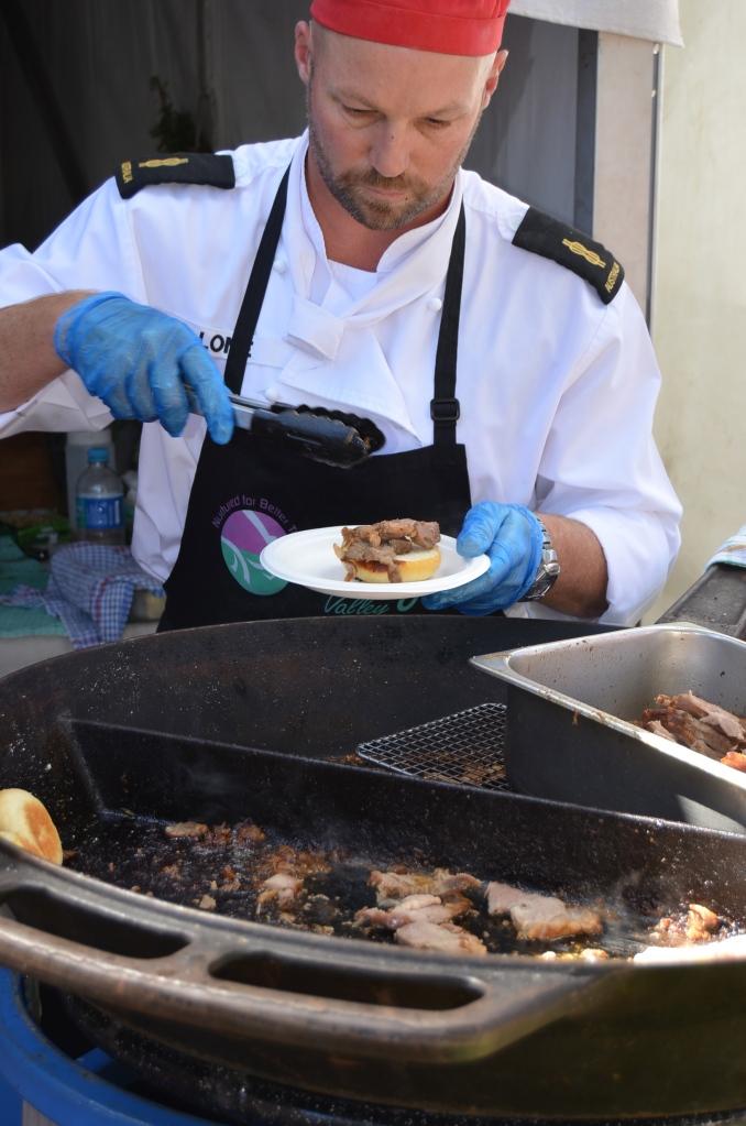 The chef making my pork brioche roll