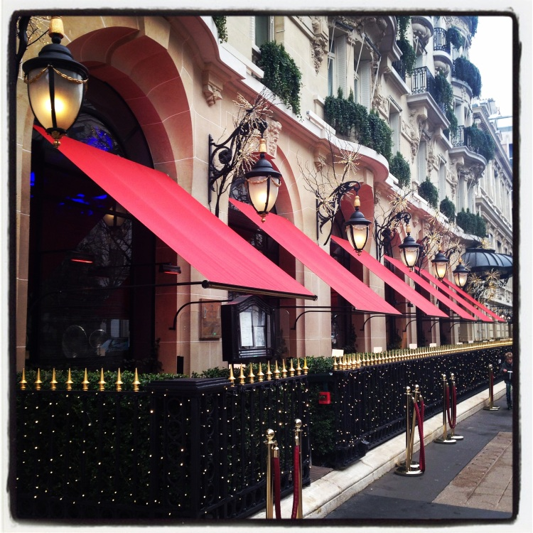 The iconic red shades of the Plaza Athenee
