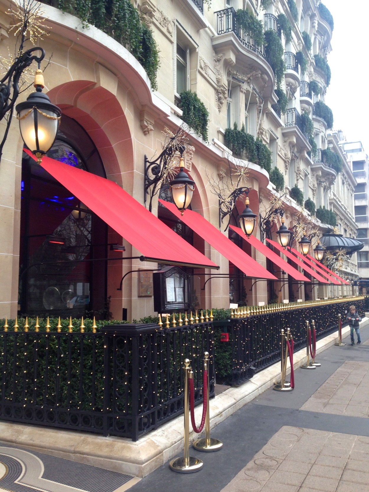 The iconic red awnings of the Hôtel Plaza Athénée