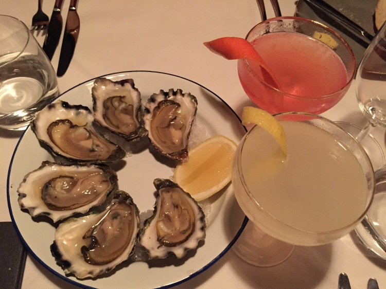 Oysters and a signature cocktail